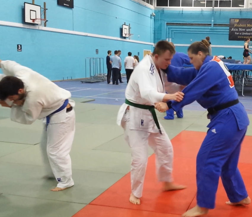 Gatis and Yannis on the tatami with Karina Bryant