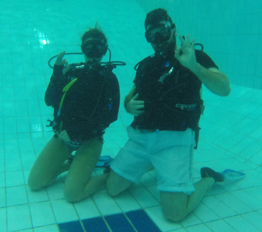 Sarah and Kostas showing off their scuba diving skills