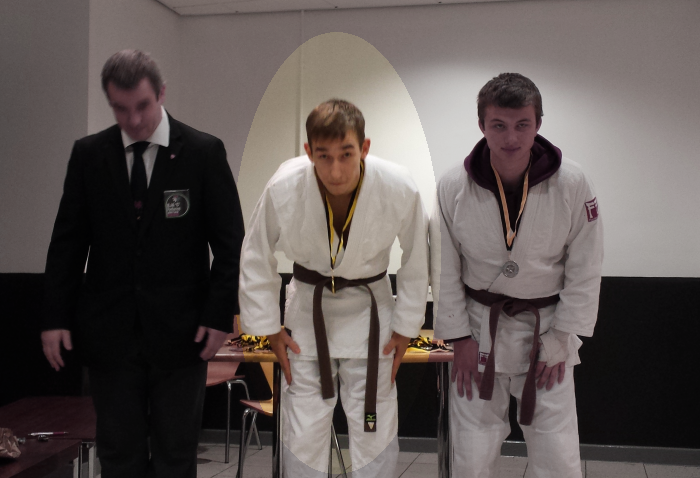 Nik receiving gold medal at Sheffield Kyu Grade competition