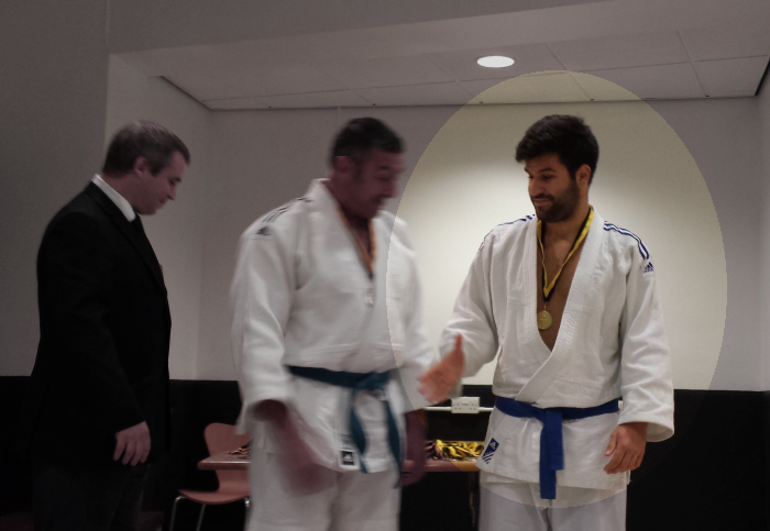 Yannis receiving gold medal at Sheffield Kyu Grade competition