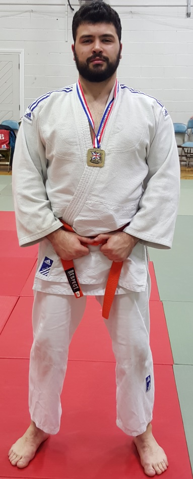 Bradford University Judo Club president stands proud after winning the gold medal in the <100kg Kyu grade category